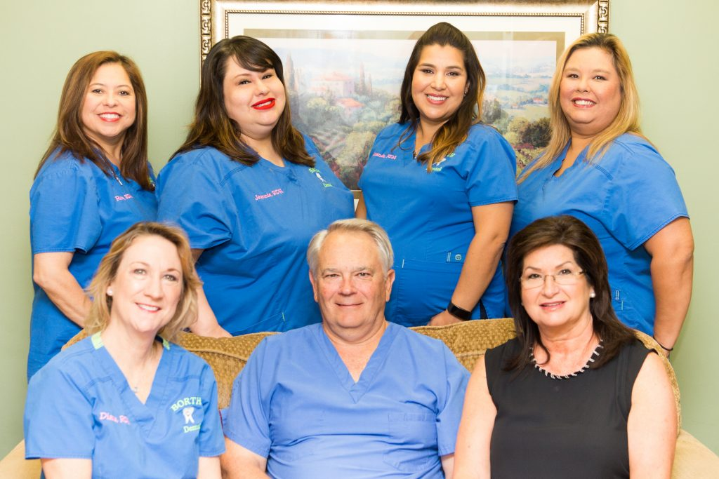 Dr. Russell D. Borth and his friendly staff inside their Corpus Christi dental office.